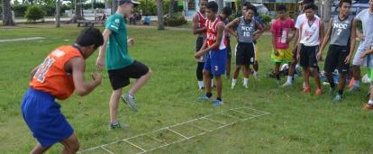 Players learn speed and coordination through our volunteer sports coaching in the Philippines